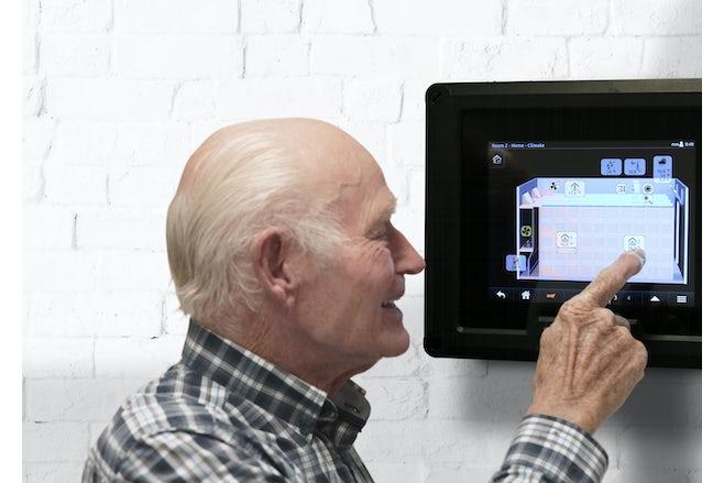 Old farmer touching the Croptimiz r